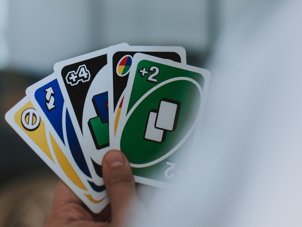 Person holding UNO cards: Photo by fotografierende from Pexels